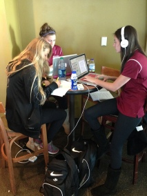 Ashley Letrich, Ashleigh Bandimere and Sydni Estrella doing homework before the flight.